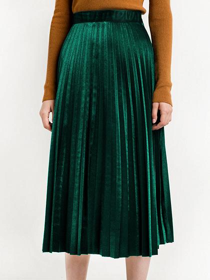 Jupe mi-longue plissée en velours vert