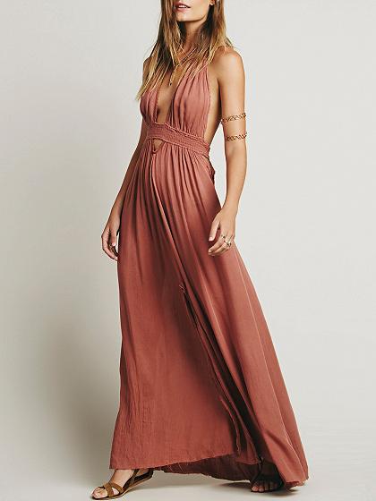 Vestido largo con espalda descubierta y abertura en el muslo rosa